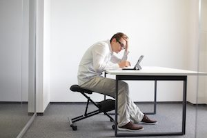 bad sitting posture at workstation